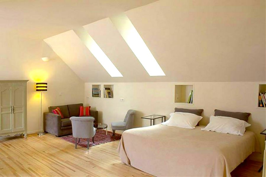 The loft apartment bedroom with double bed and sofa bed