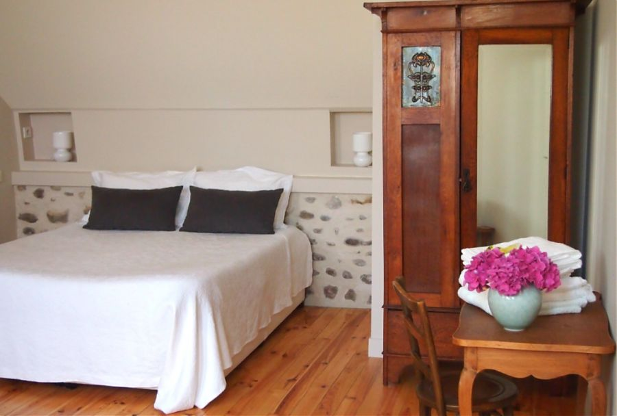 bed wardrobe and desk in winery studio holiday let at Clos Mirabel
