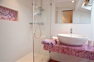 bathroom - shower and sink with pink mosaic tiles