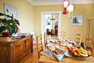 The dining room with fruit and croissants for breakfast