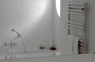 bathroom with bath, shower and towel rack