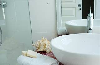 Bathroom - wash basin-soap-towel-and-decorative-shell