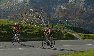 two men on bikes cycling past the aubisque summet