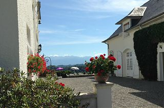 The courtyard at Clos Mirabel with views of flowers and mountains