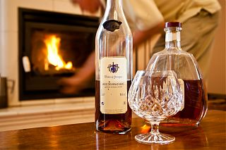 Enjoying a glass of armagnac by the fire place in the Manor House