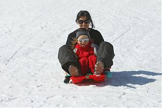 Mother and daughter on a sledge