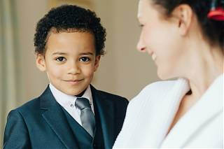Young boy in smart suit going to a wedding