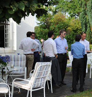 Men in suits having drinks on the terrace of Clos Mirabel