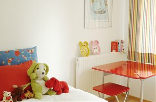 bedroom with soft toys and desk
