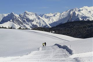 couple cross country skiing in the mountains